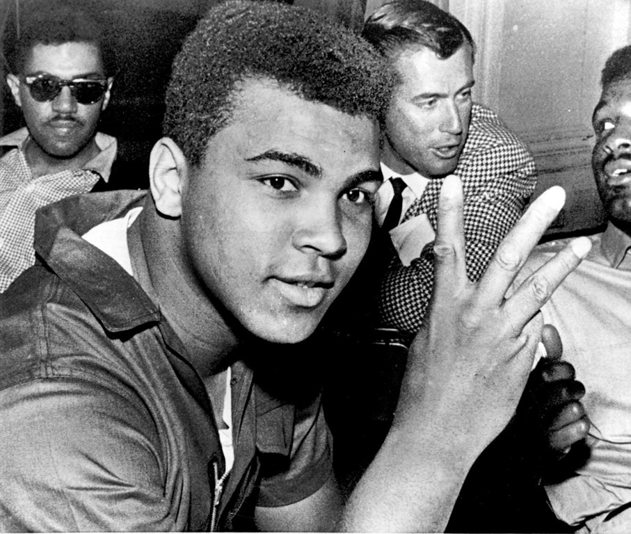 """. MIAMI, FLA., Mar.9--CASSIUS WILL TAKE ALL THREE AND QUIT--Cassius Clay said at a news conference, he wants to fight Ernest Terrell, Floyd Patterson and George Chuvalo in a single night and them retire from the ring.  He said \""""a man in my tax bracket can\'t afford to fight more than once a year.  I want to get them all out of the way at once, so I can retire.\"""" 1965 Credit: AP"""