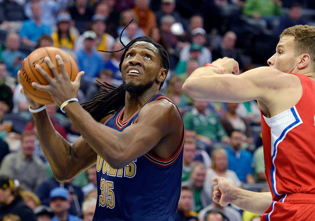 . Denver Nuggets forward Kenneth Faried (35) looks to the basket as Los Angeles Clippers forward Blake Griffin (32) comes in on defense during the first quarter March 17, 2014 at the Pepsi Center. (Photo by John Leyba/The Denver Post)