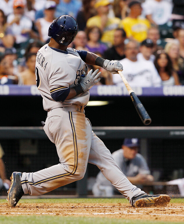 . Milwaukee Brewers\' Jean Segura reacts after fouling off an inside pitch against the Colorado Rockies in the fourth inning of a baseball game in Denver on Saturday, July 27, 2013. (AP Photo/David Zalubowski)