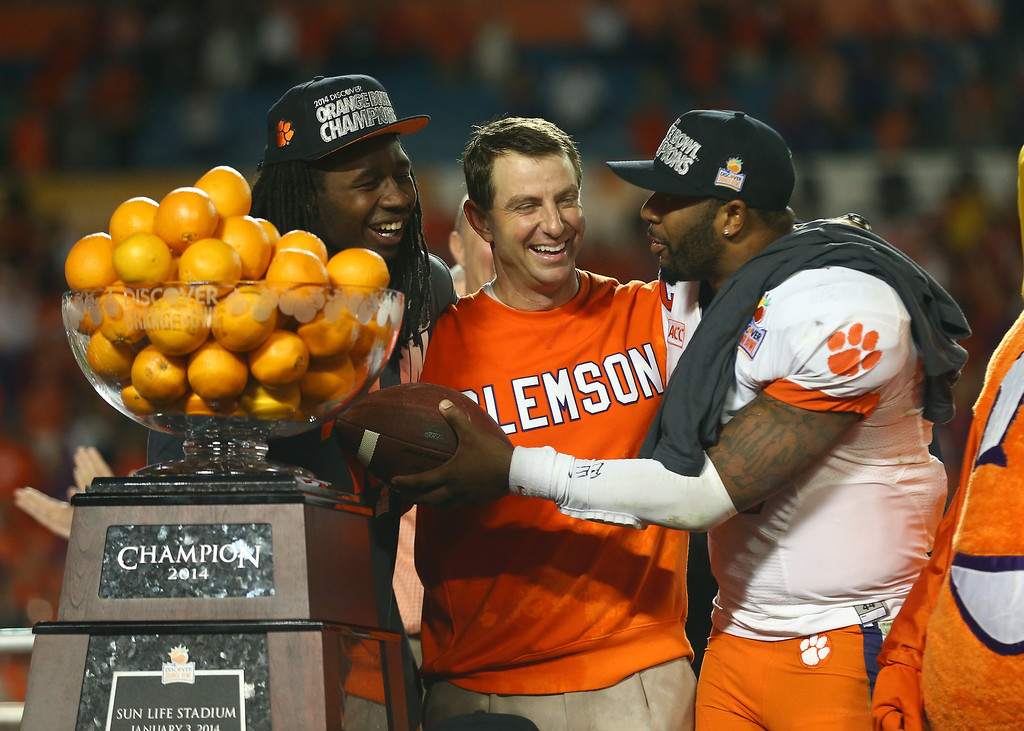 . MIAMI GARDENS, FL - JANUARY 03:  (L-R) Sammy Watkins #2, head coach Dabo Swinney and Tajh Boyd #10 of the Clemson Tigers celebrate after defeating the Ohio State Buckeyes during the Discover Orange Bowl at Sun Life Stadium on January 3, 2014 in Miami Gardens, Florida. Clemson defeated Ohio State 40-35.  (Photo by Streeter Lecka/Getty Images)