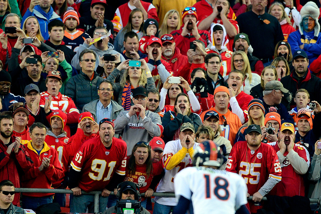 . Kansas City Chiefs fans shout as Peyton Manning (18) of the Denver Broncos waits for the snap during the first half of the Broncos\' 35-28 win at Arrowhead Stadium.   (Photo by AAron Ontiveroz/The Denver Post)