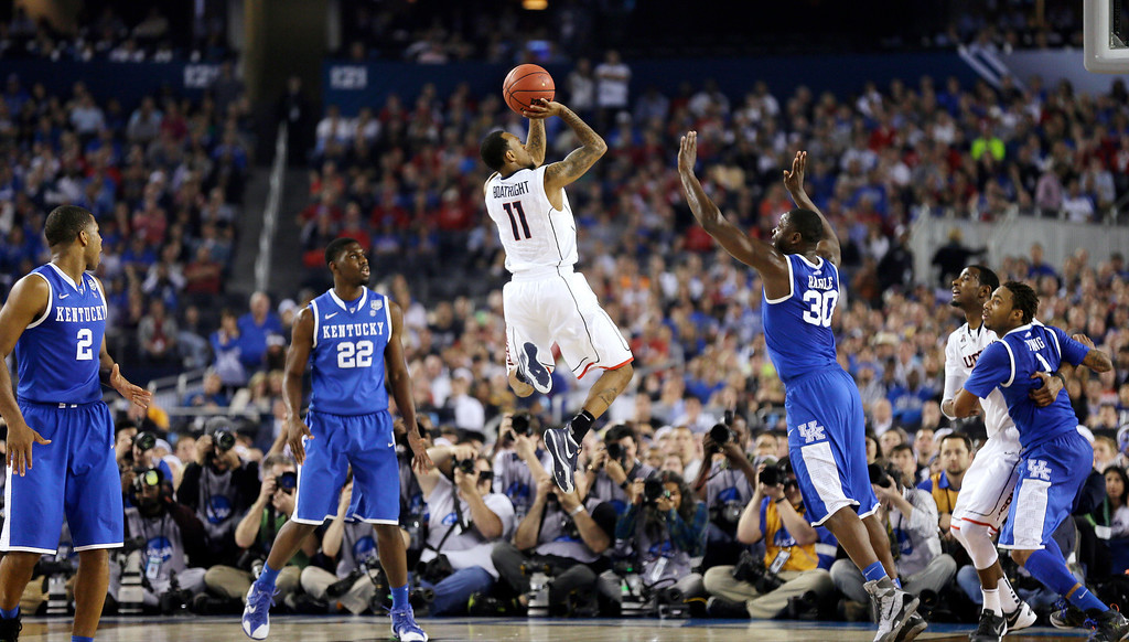 . Connecticut guard Ryan Boatright (11) shoots over Kentucky forward Julius Randle (30) during the second half of the NCAA Final Four tournament college basketball championship game Monday, April 7, 2014, in Arlington, Texas. (AP Photo/Charlie Neibergall)