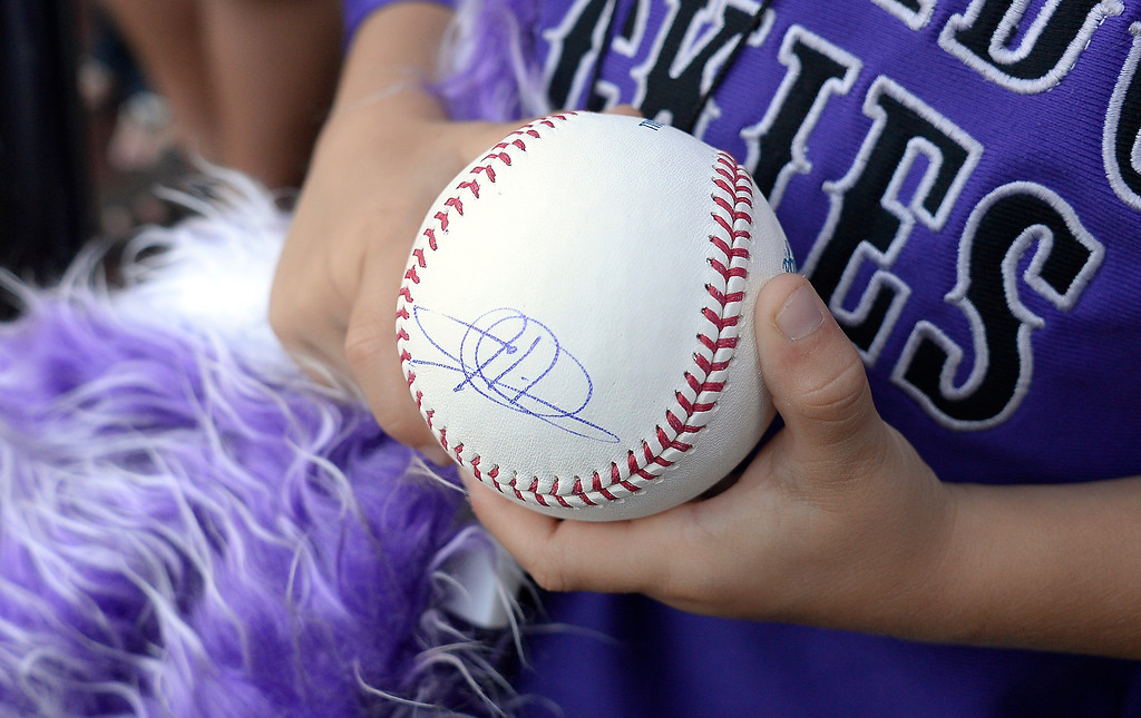 . Todd Helton (17) of the Colorado Rockies signs autographs for fans in his last game September 25, 2013 at Coors Field. Helton will retire at the end of the season after 17 years with the club. (Photo By John Leyba/The Denver Post)