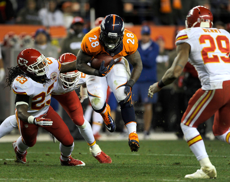 . Kansas City Chief Kandrick Lewis dives for Montee Ball as he carries the ball down field. The Denver Broncos take on the Kansas City Chiefs at Sports Authority Field on Nov. 17, 2013.   (Photo By Erin Hull/The Denver Post)
