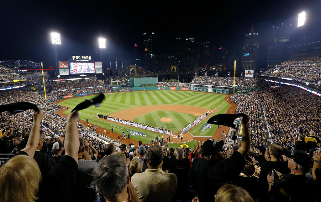 . Fans wave towels at the finish of the national anthem before the NL wild-card playoff baseball game between the Pittsburgh Pirates and the Cincinnati Reds on Tuesday, Oct. 1, 2013, in Pittsburgh. (AP Photo/Keith Srakocic)