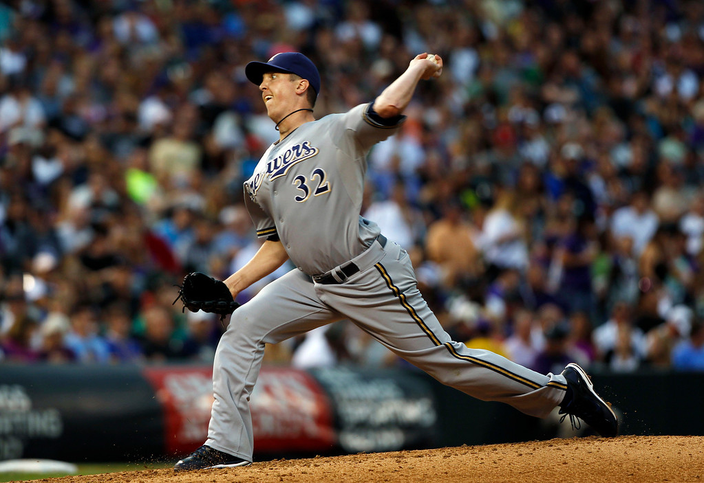 . Milwaukee Brewers starting pitcher Tom Gorzelanny works against the Colorado Rockies in the third inning of a baseball game in Denver on Saturday, July 27, 2013. (AP Photo/David Zalubowski)