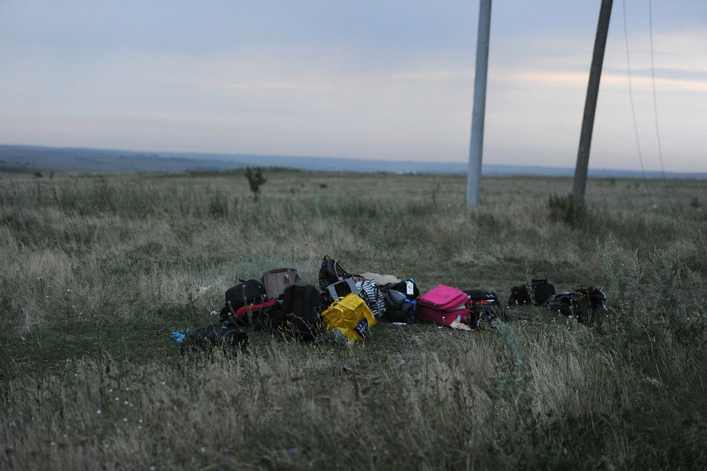 . Luggages are pictured on July 17, 2014 on the site of the crash of the malaysian airliner carrying 295 people from Amsterdam to Kuala Lumpur, near the town of Shaktarsk, in rebel-held east Ukraine. Pro-Russian rebels fighting central Kiev authorities claimed on Thursday that the Malaysian airline that crashed in Ukraine had been shot down by a Ukrainian jet. The head of Ukraine\'s air traffic control agency said Thursday that the crew of the Malaysia Airlines jet that crashed in the separatist east had reported no problems during flight. AFP PHOTO/DOMINIQUE FAGET/AFP/Getty Images