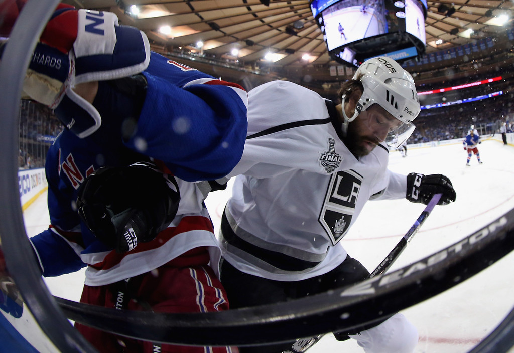 . Justin Williams #14 of the Los Angeles Kings and Brad Richards #19 of the New York Rangers battle for the puck during the first period of Game Three of the 2014 NHL Stanley Cup Final at Madison Square Garden on June 9, 2014 in New York, New York.  (Photo by Bruce Bennett/Getty Images)