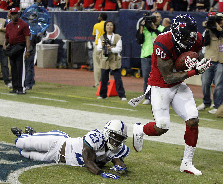 . Andre Johnson #80 of the Houston Texans grabs a five yard pass away from Vontae Davis #23 of the Indianapolis Colts for a touchdown in the second quarter at Reliant Stadium on November 3, 2013 in Houston, Texas.  (Photo by Bob Levey/Getty Images)