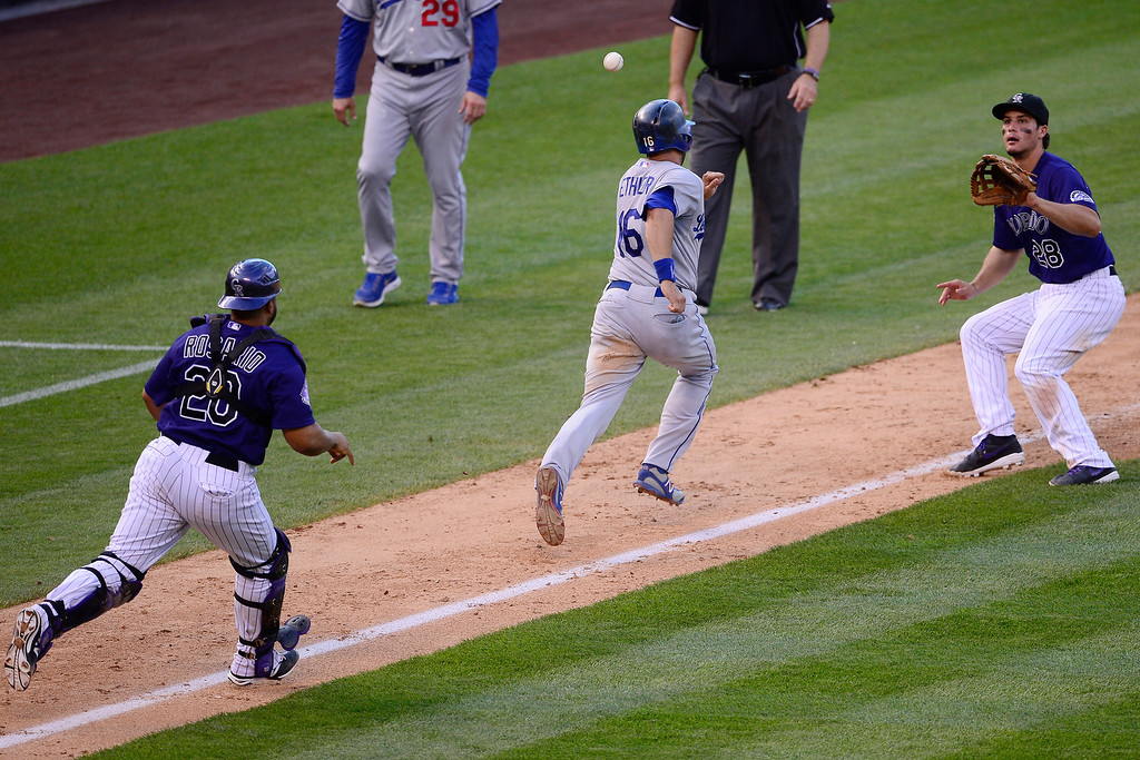 . Rockies third baseman Nolan Arenado, right, and catcher Wilin Rosario (20) chase down Andre Ethier of the Dodgers in a pickle Andre Ethier en route to an out during the Dodgers\' 10-8 win in Denver on September 2, 2013.   (Photo by AAron Ontiveroz/The Denver Post)
