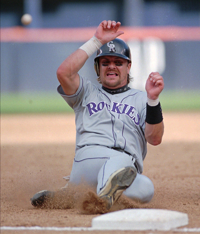 . LARRY WALKER -- Colorado Rockies Larry Walker slides safely into third while advancing from first in the ninth inning of the Rockies\' game against the San Diego Padres on Sept. 18, 1997 in San Diego.   (AP Photo/Mike Poche)