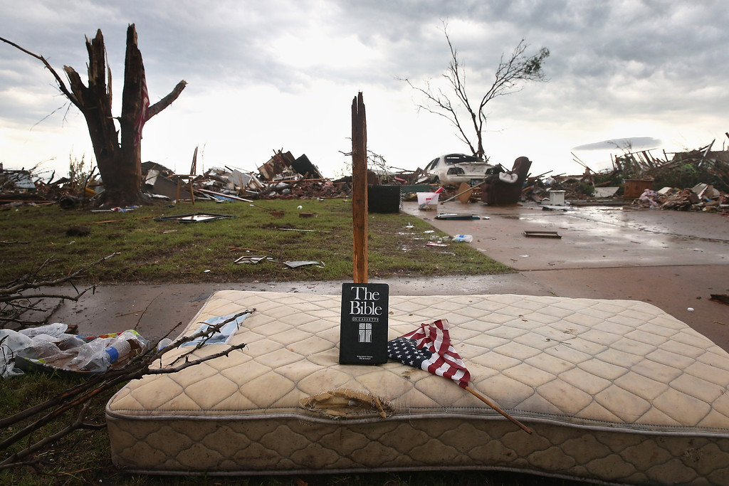 . MOORE, OK - MAY 23:  A copy of the Bible on cassette sits alongside debris in front of a home after it was destroyed by a tornado May 23, 2013 in Moore, Oklahoma. The two-mile wide EF5 tornado touched down May 20 killing at least 24 people and leaving behind extensive damage to homes and businesses. U.S. President Barack Obama promised federal aid to supplement state and local recovery efforts.  (Photo by Scott Olson/Getty Images)