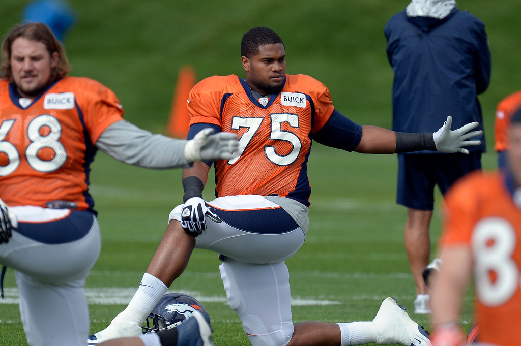. Denver Broncos LT Chris Clark (75) stretches before practice September 19, 2013 at Dove Valley. Clark will take the place of injured player Ryan Clady. (Photo by John Leyba/The Denver Post)