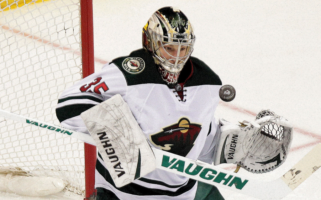 . Minnesota Wild goalie Darcy Kuemper makes a save against the Colorado Avalanche during the first period of an NHL hockey game Thursday, Jan. 30, 2014, in Denver. (AP Photo/Barry Gutierrez)