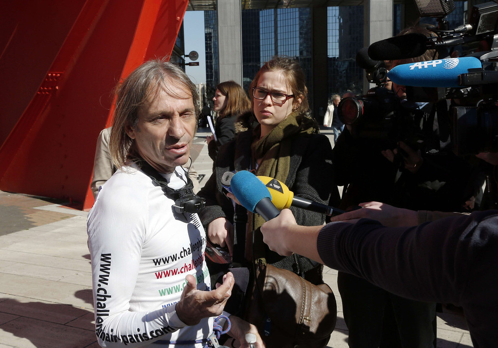 . Alain Robert, the French urban climber dubbed Spiderman, speaks to the press after climbing the Total company\'s headquarters, a 186-meter high skyscraper, at the business district of La Defense, near Paris, on March 20, 2014.  AFP PHOTO / FRANCOIS GUILLOT/AFP/Getty Images