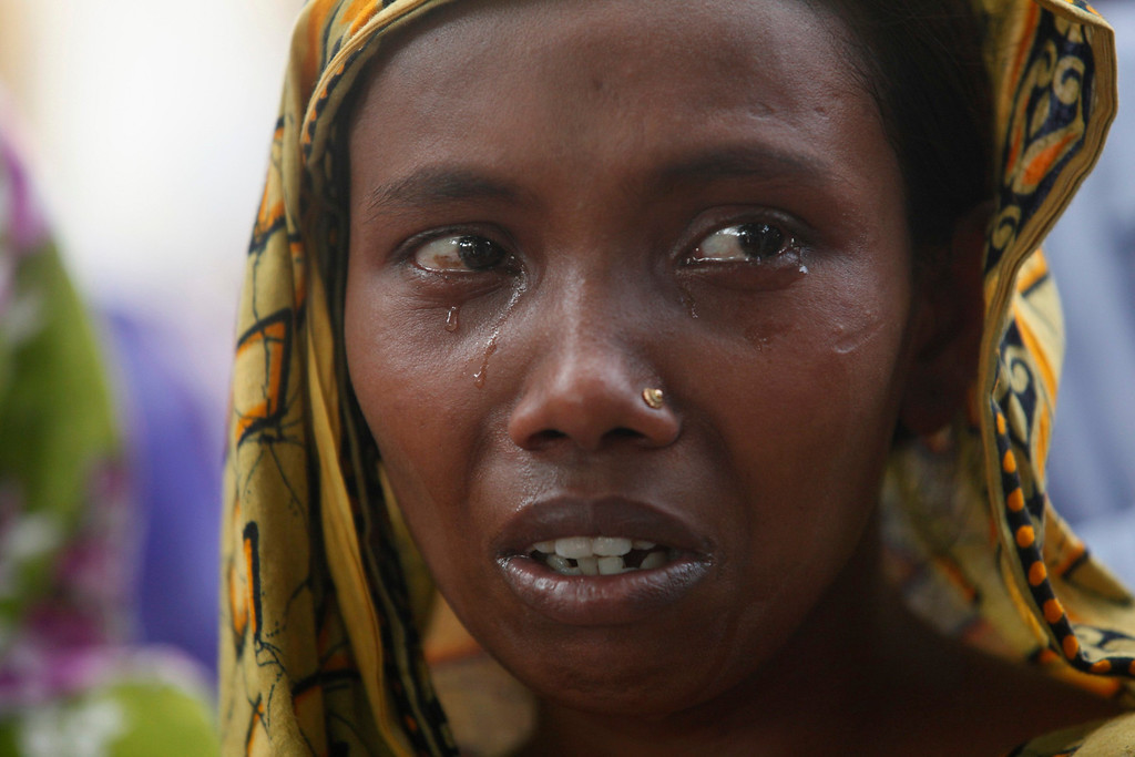 . A woman cries as she waits for news of her relative, a garment worker who is still missing, after the collapse of the Rana Plaza building in Savar, outside Dhaka April 30, 2013. REUTERS/Andrew Biraj
