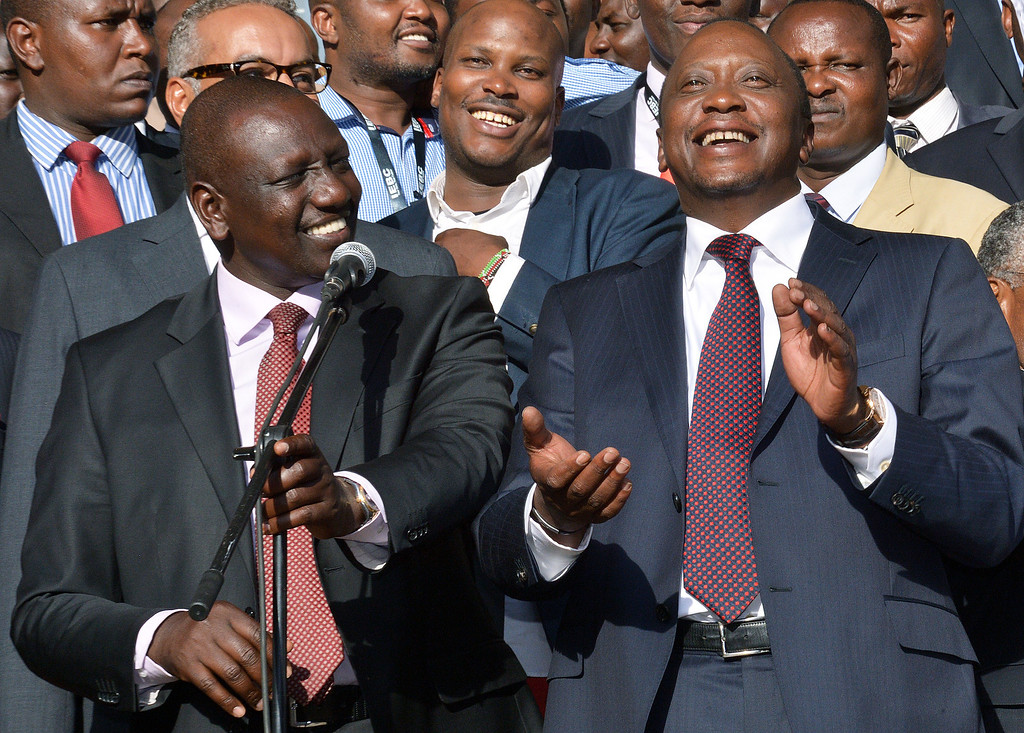 . Newly elected President Uhuru Kenyatta (R) and running mate William Ruto (L) are pictured, following his victory in Kenya\'s national elections in Nairobi on March 9, 2013. Kenyatta will face charges at the International criminal court in July 2013. The elections have been marred by long delays as votes were counted and verified. AFP PHOTO/ Carl DE SOUZA/AFP/Getty Images