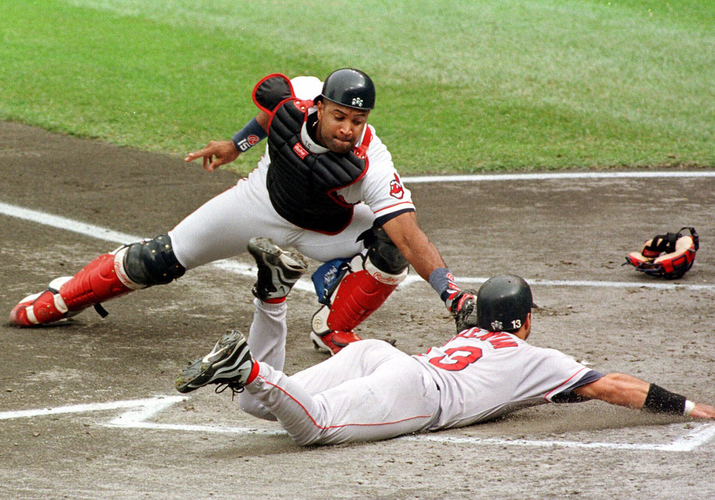 . SANDY ALOMAR -- Cleveland Indians catcher Sandy Alomar reaches out to tag out Boston Red Sox runner John Valentin trying to score on Nomar Garciaparra\'s first inning double on Sept. 30, 1998, in Cleveland.  (AP Photo/Phil Long)