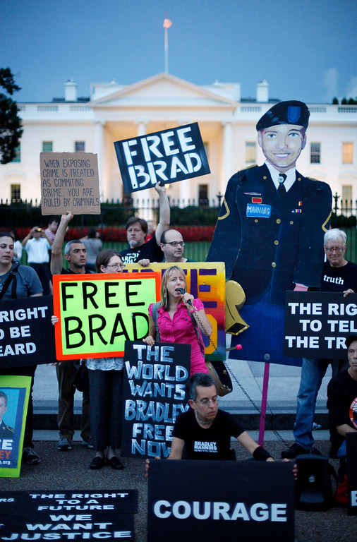 . Supporters of Army Pfc. Bradley Manning demonstrate in front of the White House during a rally in Washington, Wednesday, Aug. 21, 2013. Manning was sentenced earlier in the day to 35 years in prison for leaking classified information to WikiLeaks. (AP Photo/Pablo Martinez Monsivais)