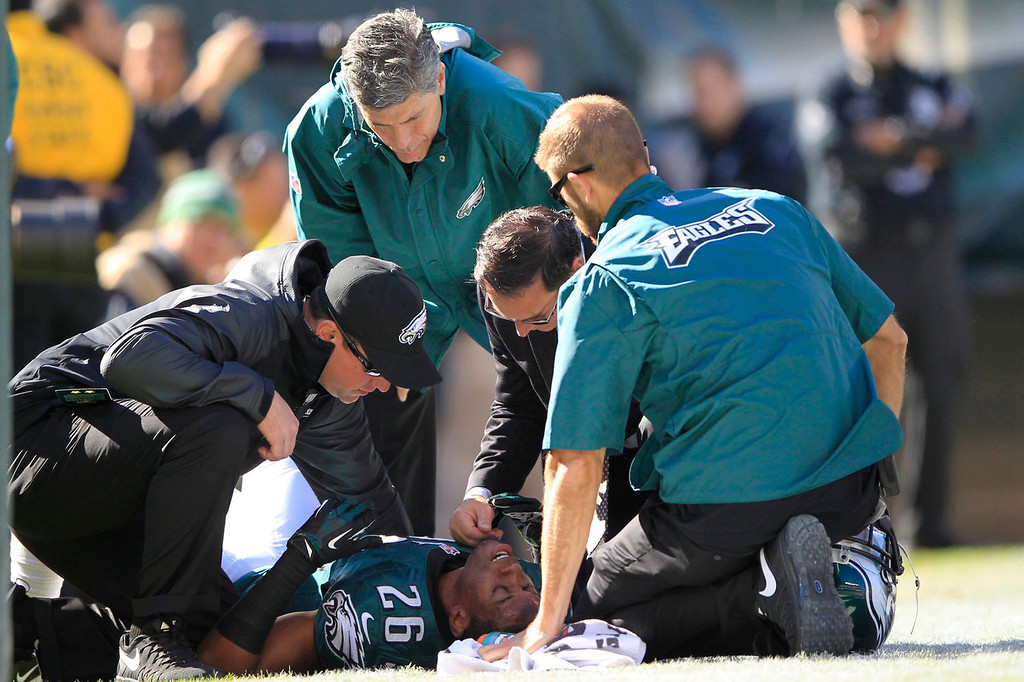 . Trainers check on Philadelphia Eagles\' Cary Williams (26) after he was injured during the first half of an NFL football game against the New York Giants Sunday, Oct. 27, 2013, in Philadelphia. (AP Photo/MR)