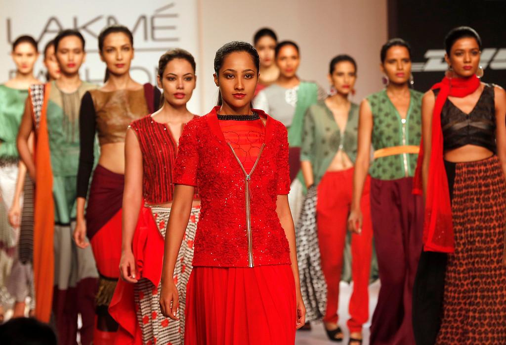 . Models walk the ramp to showcase creations by Sougat Paul during the Lakme Fashion Week in Mumbai, India, Wednesday,  March 12, 2013. (AP Photo/Rajanish Kakade)