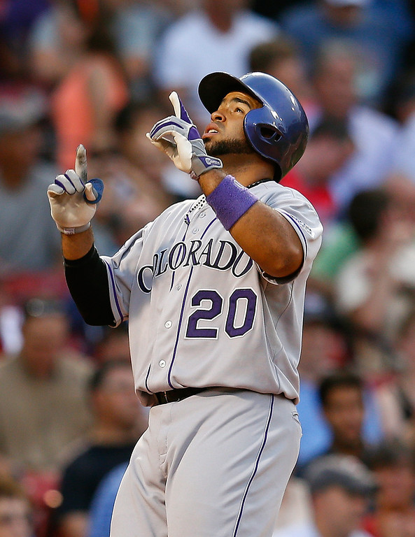 . Wilin Rosario #20 of the Colorado Rockies reacts in the 2nd inning after hitting a home run on a pitch by Ryan Dempster #46 of the Boston Red Sox at Fenway Park on June 25, 2013 in Boston, Massachusetts.  (Photo by Jim Rogash/Getty Images)