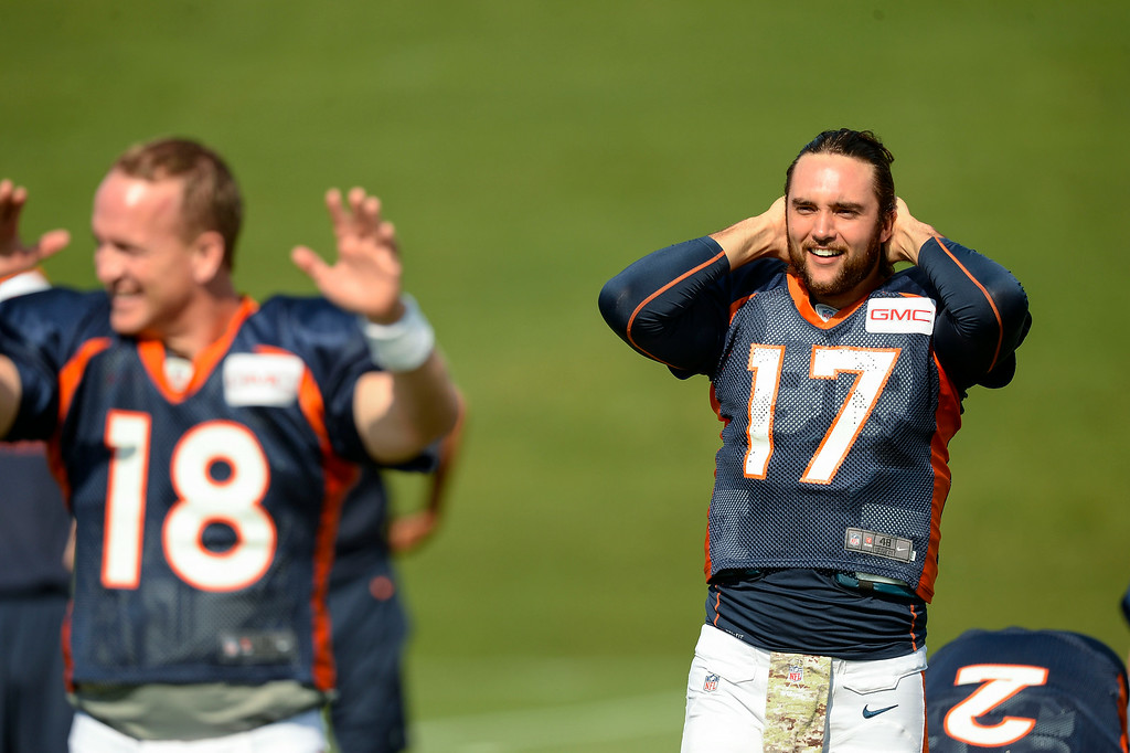 . Denver Broncos quarterback Brock Osweiler (17) stretches on day five of the Denver Broncos 2014 training camp July 28, 2014 at Dove Valley. (Photo by John Leyba/The Denver Post)