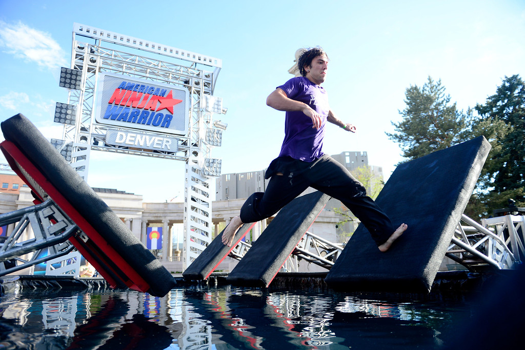 . Course tester Christian Greene runs over an obstacle before the tryout for American Ninja Warrior Denver on May 19, 2013. (Photo by AAron Ontiveroz/The Denver Post)
