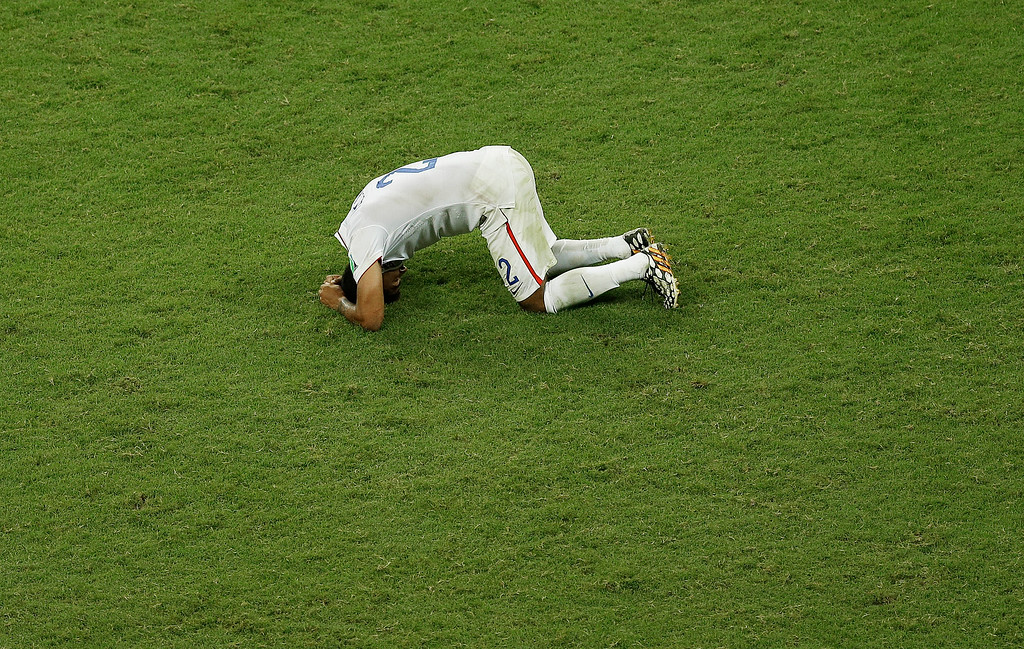 . United States\' DeAndre Yedlin rests on the pitch after the United States lost 1-2 against Belgium after extra time of the World Cup round of 16 soccer match between Belgium and the USA at the Arena Fonte Nova in Salvador, Brazil, Tuesday, July 1, 2014. (AP Photo/Themba Hadebe)