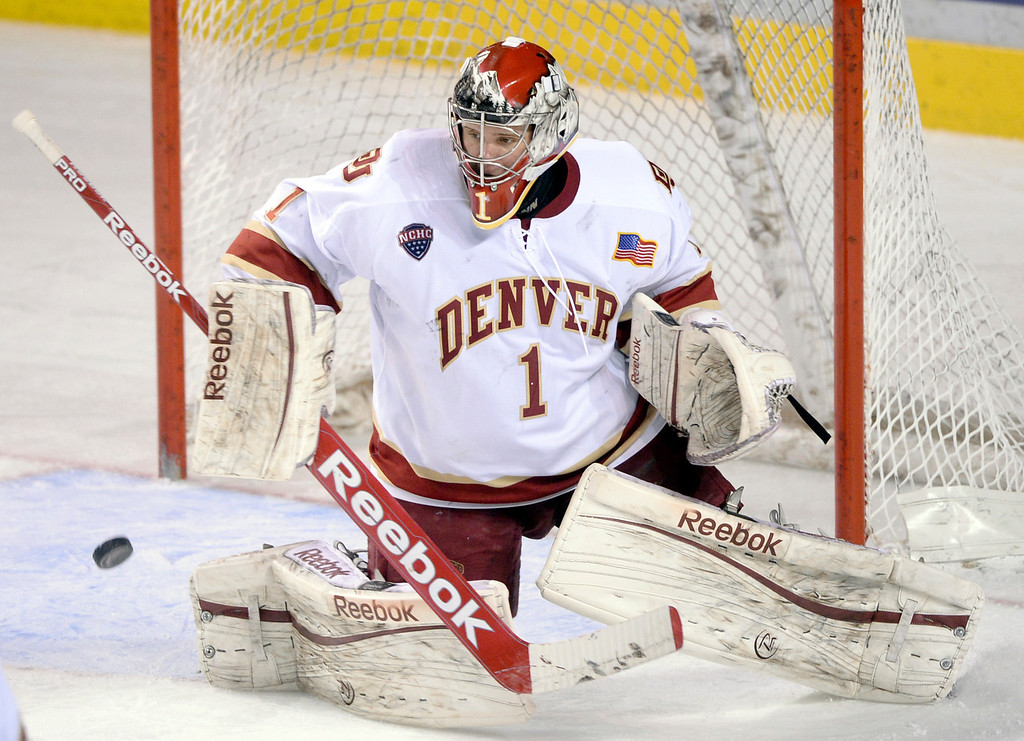 . DENVER, CO. - JANUARY 10: Denver goalie Sam Brittain made a save late in the third period. The St. Cloud State hockey team defeated the University of Denver 6-3 at Magness Arena Friday night, January 10, 2014. Photo By Karl Gehring/The Denver Post