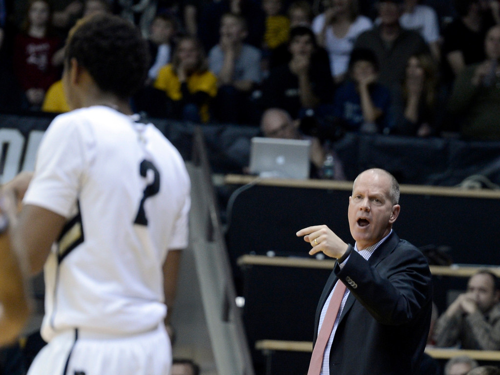 . University of Colorado head coach Tad Boyle yells to Xavier Johnson during a game against Northern Arizona on Friday, Dec. 21, at the Coors Event Center on the CU campus in Boulder.    (Jeremy Papasso/Daily Camera)