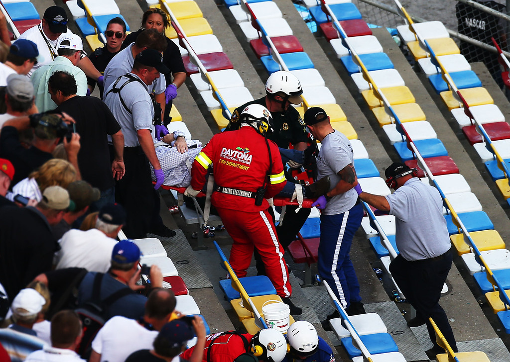 . DAYTONA BEACH, FL - FEBRUARY 23:  Medical personnel remove an injured fan from the stands following an incident at the finish of  the NASCAR Nationwide Series DRIVE4COPD 300 at Daytona International Speedway on February 23, 2013 in Daytona Beach, Florida.  (Photo by Jonathan Ferrey/Getty Images)