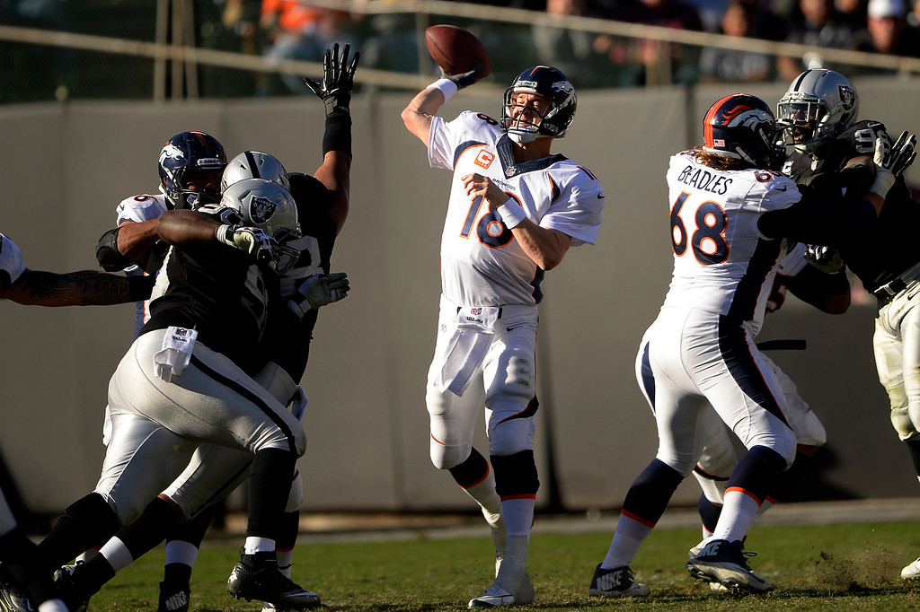. Quarterback Peyton Manning (18) of the Denver Broncos lets loose a  pass against the Oakland Raiders at O.co Coliseum December 29, 2013 Oakland, Calif. (Photo By Joe Amon/The Denver Post)