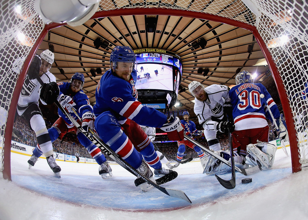 . Anton Stralman #6 of the New York Rangers defends the puck from Jeff Carter #77 of the Los Angeles Kings during the first period of Game Four of the 2014 NHL Stanley Cup Final at Madison Square Garden on June 11, 2014 in New York, New York.  (Photo by Bruce Bennett/Getty Images)