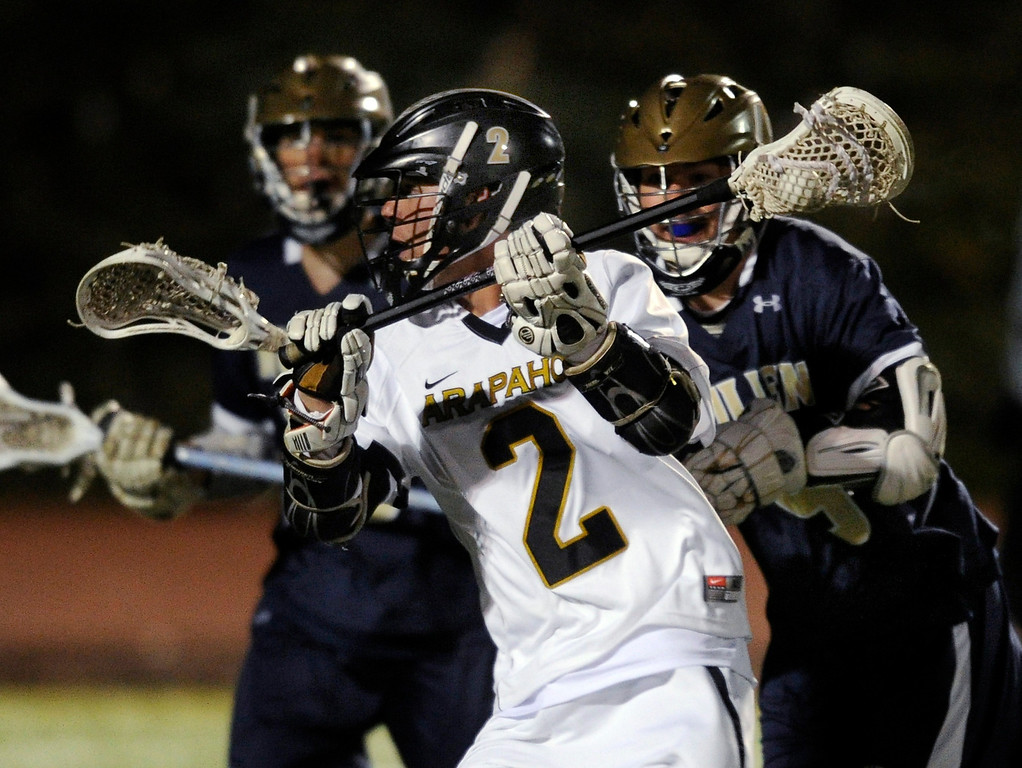 . LITTLETON, CO. - APRIL 10: Warriors senior middie Michael Babb (2) went on the attack in the fourth quarter. The Mullen High School boy\'s lacrosse team defeated Arapahoe 8-7 Wednesday night, April 10, 2013. Photo By Karl Gehring/The Denver Post)