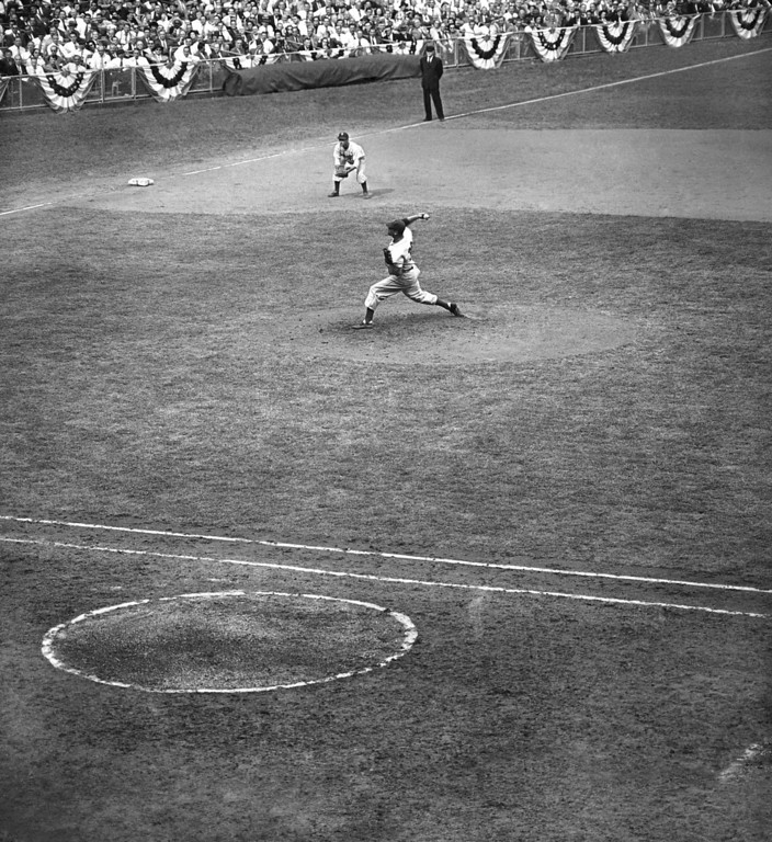 . Brooklyn Dodgers hurler Don Newcombe, center, is shown in action in the first game of the World Series at Yankee Stadium, Oct. 5, 1949, New York. Newcombes hurling kept the Yankee Hitters in check for eight Innings, but in the ninth inning, with the score deadlocked at 0 to 0, Tommy Henrich, Yankees First baseman, caught one of Newcombes pitches and deposited the ball into the right field stands for a game winning, tie-breaking homer. (AP Photo)