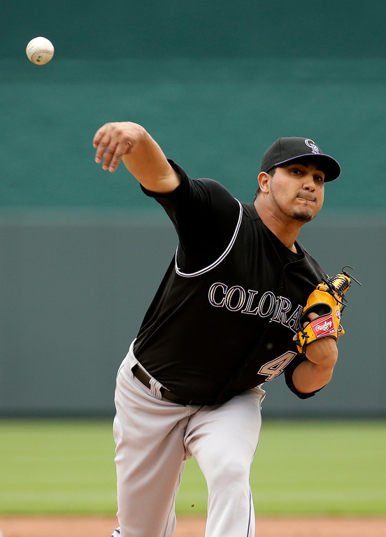 . Colorado Rockies starting pitcher Jhoulys Chacin throws during the first inning of a baseball game against the Kansas City Royals Wednesday, May 14, 2014 in Kansas City, Mo. (AP Photo/Charlie Riedel)