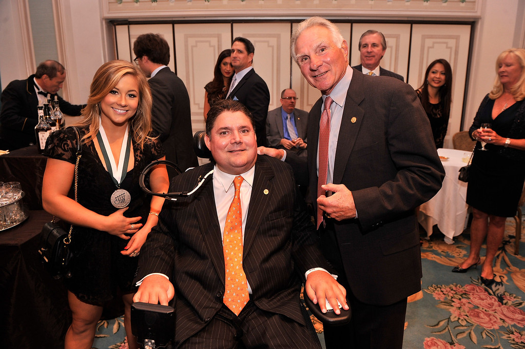 . (L-R)  Legend and Olympic gymnast Shawn Johnson, President of Buoniconti Fund, Marc Buoniconti and Founder and CEO of The Buoniconti Fund, Nick Buoniconti attend the 28th Annual Great Sports Legends Dinner to Benefit The Buoniconti Fund To Cure Paralysis at The Waldorf Astoria on September 30, 2013 in New York City.  (Photo by Stephen Lovekin/Getty Images for The Buoniconti Fund To Cure Paralysis)
