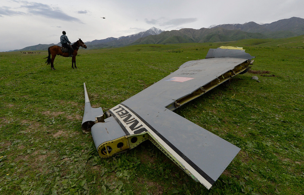 . A U.S. Air Force KC-135 tanker aircraft wreckage is strewn across a field near the village of Chaldovar, about 100 miles (160 kms) west of the Kyrgyz capital Bishkek, Friday May 3, 2013.  (AP Photo/Vladimir Voronin)