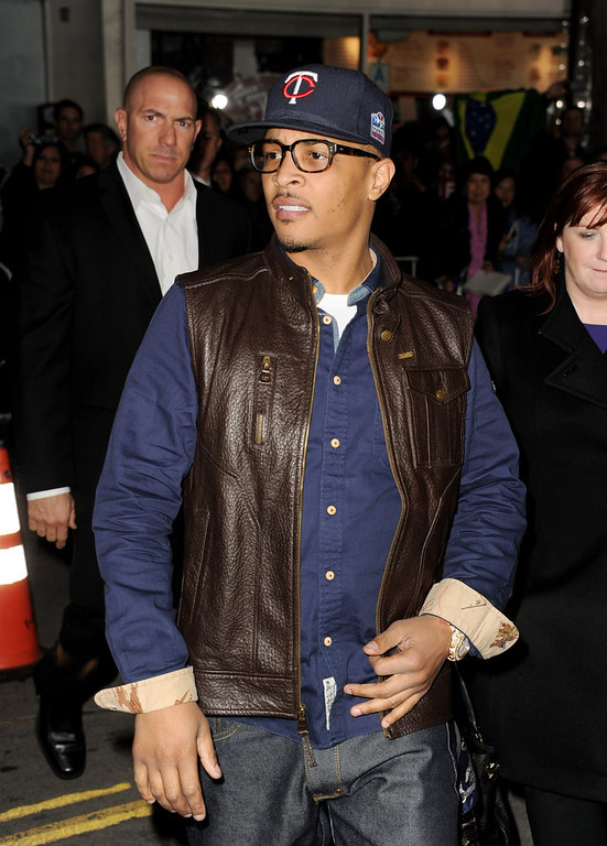 """. Actor/rapper T.I. arrives at the premiere of Universal Pictures\' \""""Identity Theft\"""" at the Village Theatre on February 4, 2013 in Los Angeles, California.  (Photo by Kevin Winter/Getty Images)"""