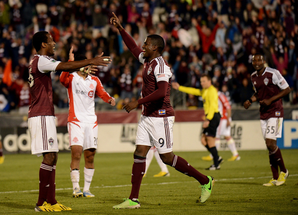. COMMERCE CITY, CO. - MAY 04 : Colorado Rapids Danny Mwanga #55, left, Edson Buddle #9 celebrate Buddle\'s winning goal of the game against Toronto FC at Dick\'s Sporting Goods Park in Commerce City, Colorado. May 4, 2013. Colorado won 1-0. (Photo By Hyoung Chang/The Denver Post)