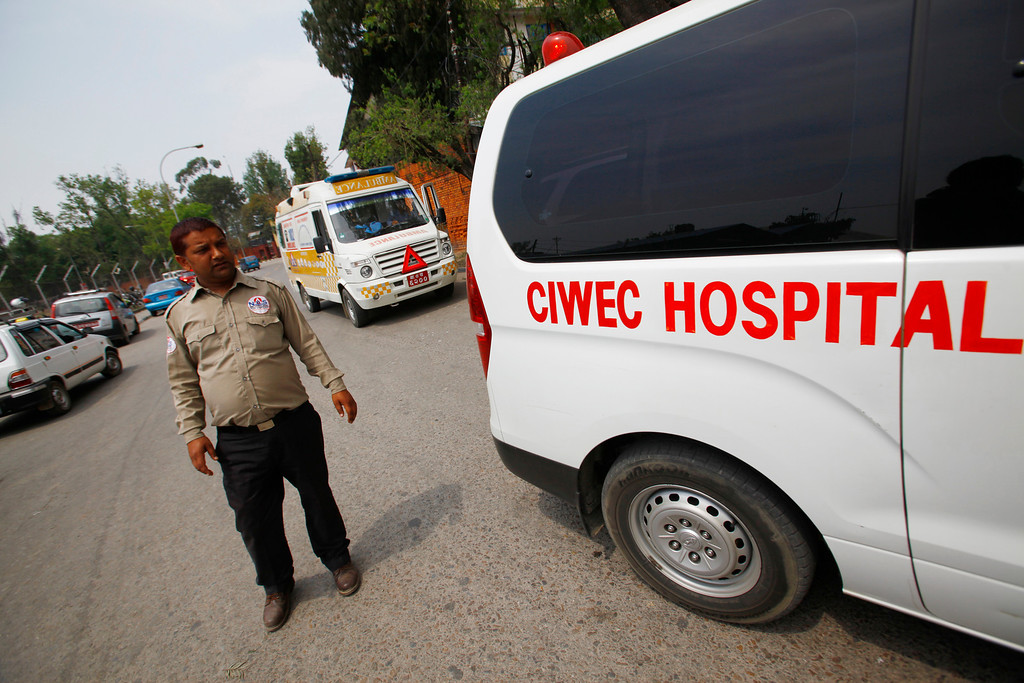 . Ambulances are seen waiting outside the Domestic Airport, waiting for injured people of avalanche to arrive, in Katmandu, Nepal, Friday, April 18, 2014. An avalanche swept down a climbing route on Mount Everest early Friday, killing at least 12 Nepalese guides and leaving three missing in the deadliest disaster on the world\'s highest peak. (AP Photo/Niranjan Shrestha)