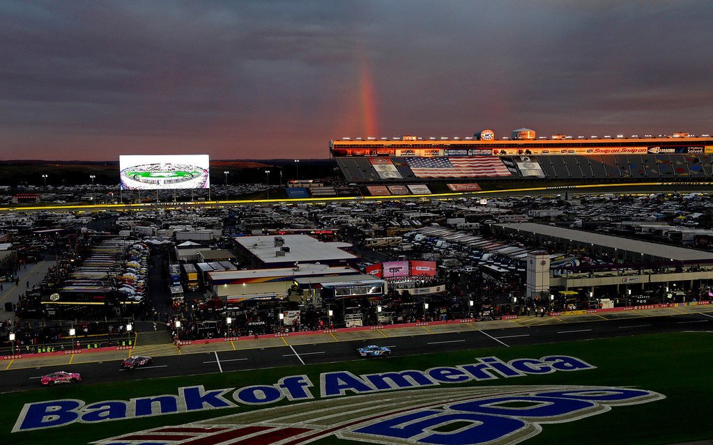 . A rainbow forms behind the backstretch grandstand at the Charlotte Motor Speedway before the NASCAR Nationwide Series auto race in Concord, N.C., Friday, Oct. 11, 2013. (AP Photo/Gerry Broome)