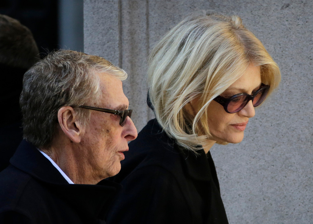 . Director Mike Nichols, left, and Diane Sawyer arrive for the funeral of actor Philip Seymour Hoffman at the Church of St. Ignatius Loyola, Friday, Feb. 7, 2014 in New York. Hoffman, 46, was found dead Sunday of an apparent heroin overdose. (AP Photo/Mark Lennihan)