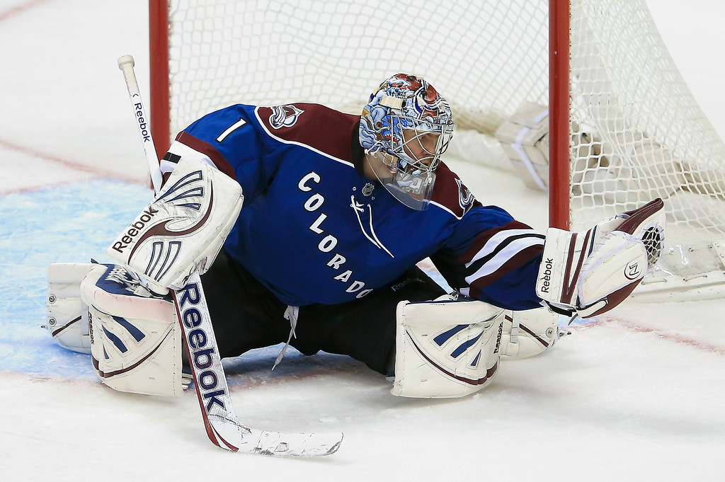 . Goalie Semyon Varlamov #1 of the Colorado Avalanche gloves the puck against the St. Louis Blues at the Pepsi Center on February 20, 2013 in Denver, Colorado. The Avalanche defeated the Blues 1-0 in overtime.  (Photo by Doug Pensinger/Getty Images)