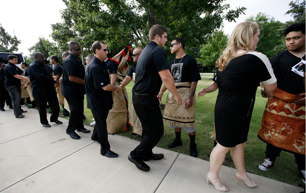 """. Members of the Texas A&M football team and staff are greeted by a receiving line at the Church of Jesus Christ Of Latter Day Saints before a funeral service for redshirt freshman Polo Manukainiu and his brother Andrew Uhatafe, Saturday, Aug. 10, 2013, in Colleyville, Texas. The two were killed in a single car accident in Northern New Mexico, July 29. Also killed was 18-year-old Utah recruit Gaius \""""Keio\"""" Vaenuku. (AP Photo/Tony Gutierrez)"""