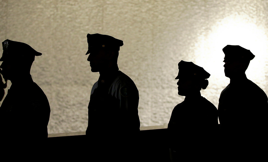 . Men in uniform walk to position at the start of the dedication ceremony for the National September 11 Memorial Museum on Thursday, May 15, 2014 in New York.  (AP Photo/John Angelillo, Pool)