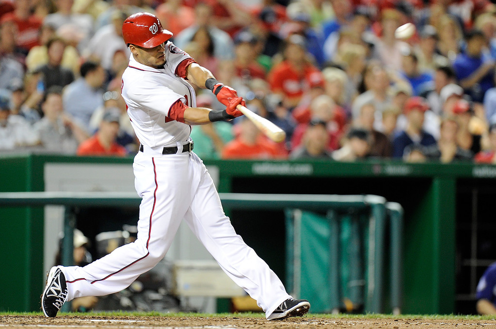 . Ian Desmond #20 of the Washington Nationals hits a home run in the seventh inning against the Colorado Rockies  at Nationals Park on June 21, 2013 in Washington, DC. Washington won the game 2-1. (Photo by Greg Fiume/Getty Images)
