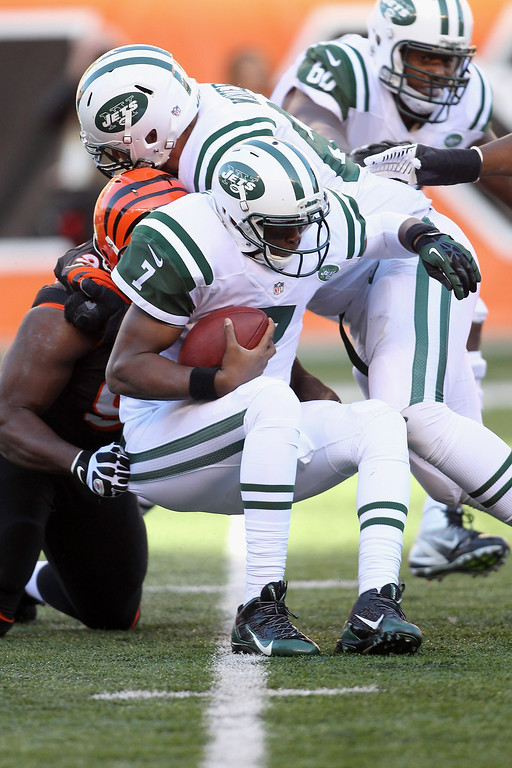 . Geno Smith #7 of the New York Jets is tackled for a loss during the game against the Cincinnati Bengals at Paul Brown Stadium on October 27, 2013 in Cincinnati, Ohio.  (Photo by John Grieshop/Getty Images)