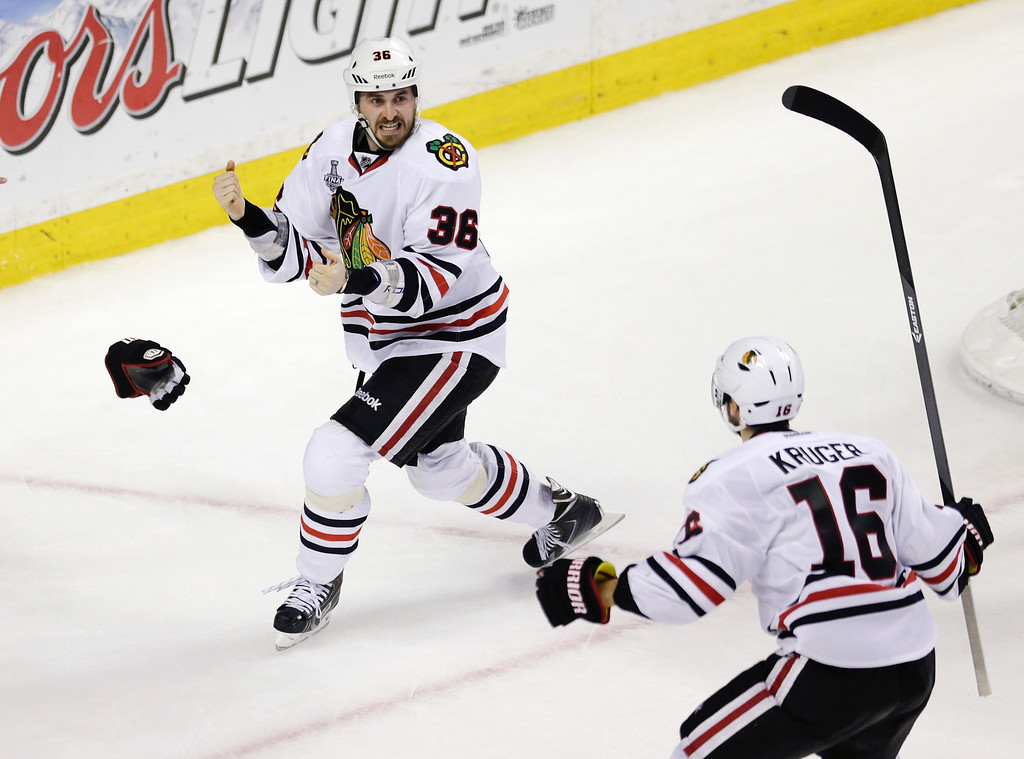 . Chicago Blackhawks center Dave Bolland (36) celebrates his game-winning goal against the Boston Bruins with Chicago Blackhawks center Marcus Kruger (16) during the third period in Game 6 of the NHL hockey Stanley Cup Finals, Monday, June 24, 2013, in Boston. The Blackhawks won 3-2. (AP Photo/Charles Krupa)